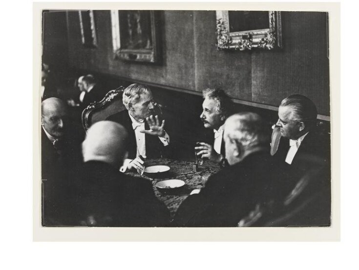 Max Planck, Prime Minister Ramsay MacDonald of England, Albert Einstein, Dr H. Dietrich, German Finance Minister, Mr Schmitz of I.G. Farben, and Dr Curtis, German Foreign Minister top image