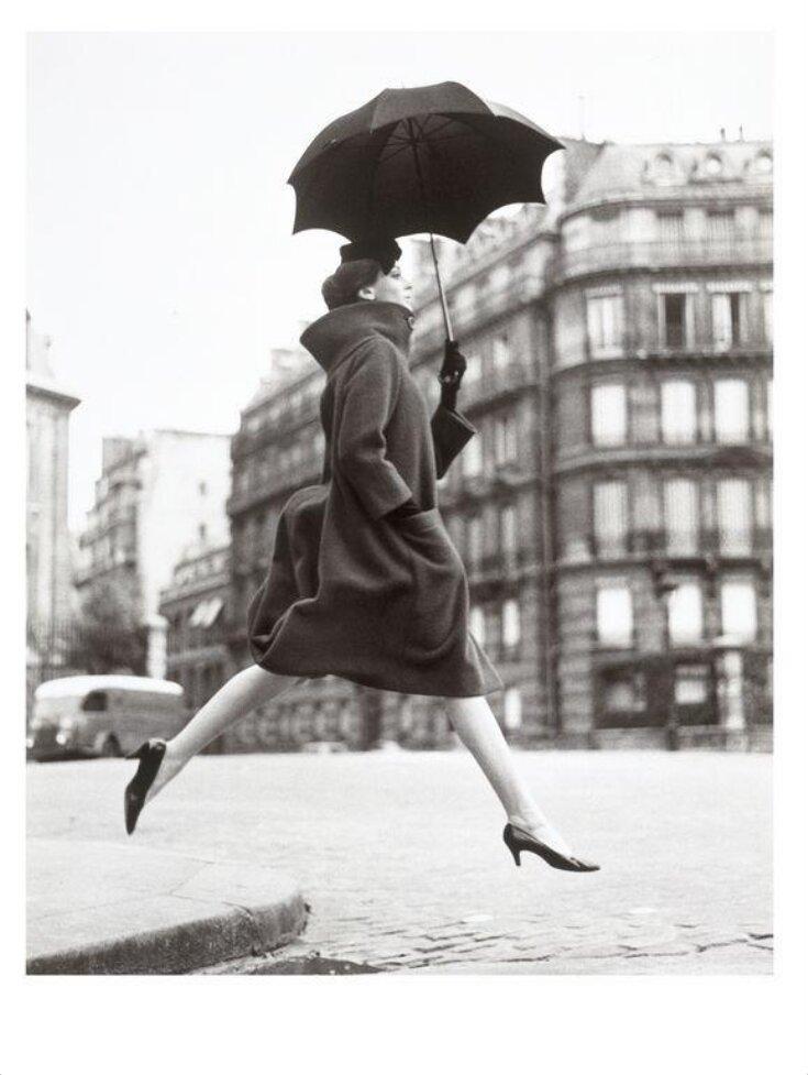 'Carmen (Homage to Munkacsi), coat by Cardin', Place Francois-Premier, Paris, 1957 top image