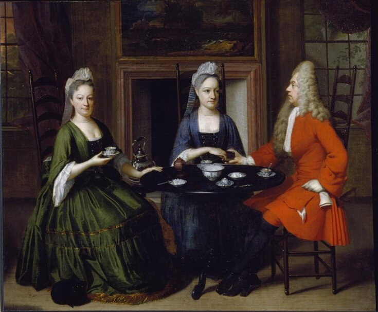 Two ladies and an officer seated at tea top image
