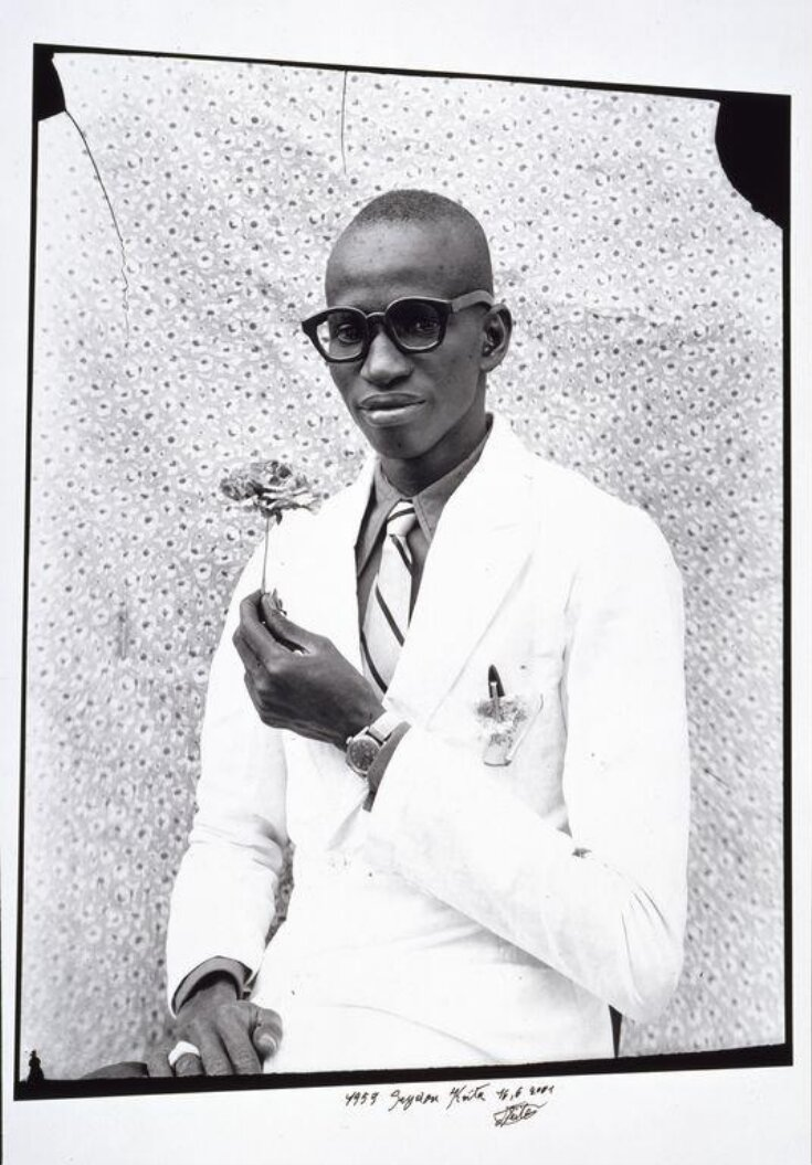 Young Man with a Flower top image