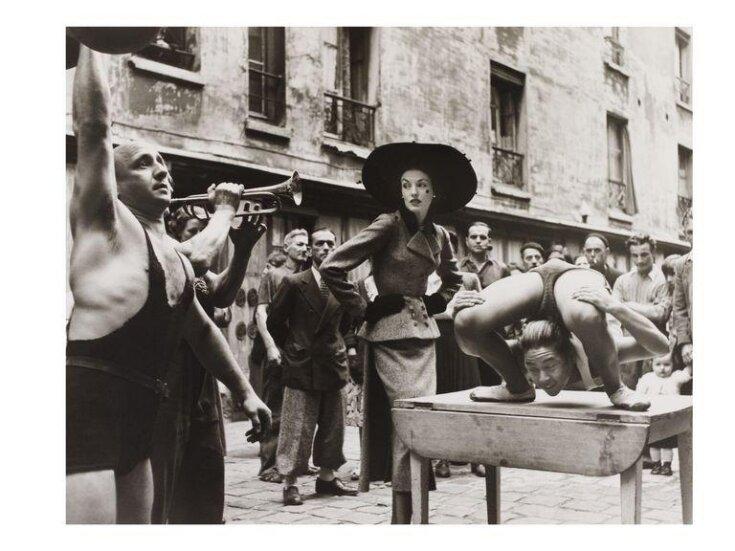 Elise Daniels with Street performers, suit by Balenciaga, Le Marais, Paris, August 1948.  top image