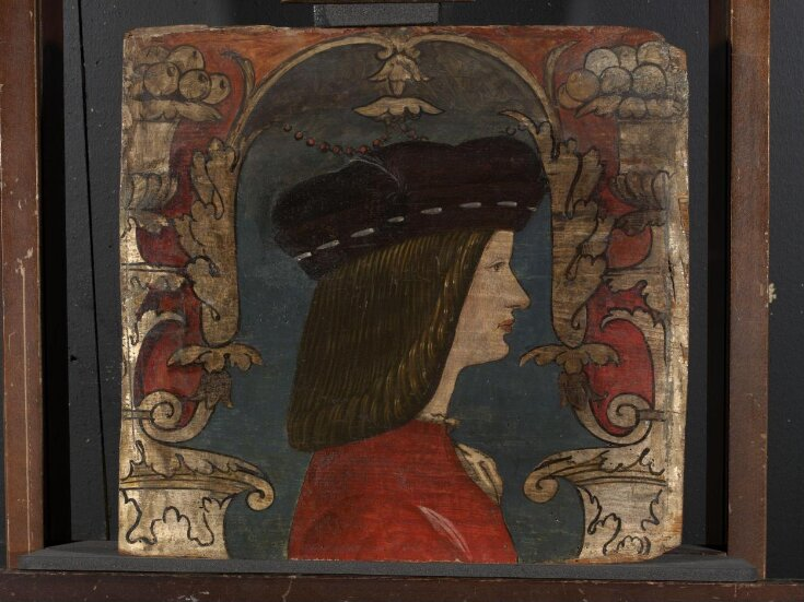 Profile bust of a man facing right top image