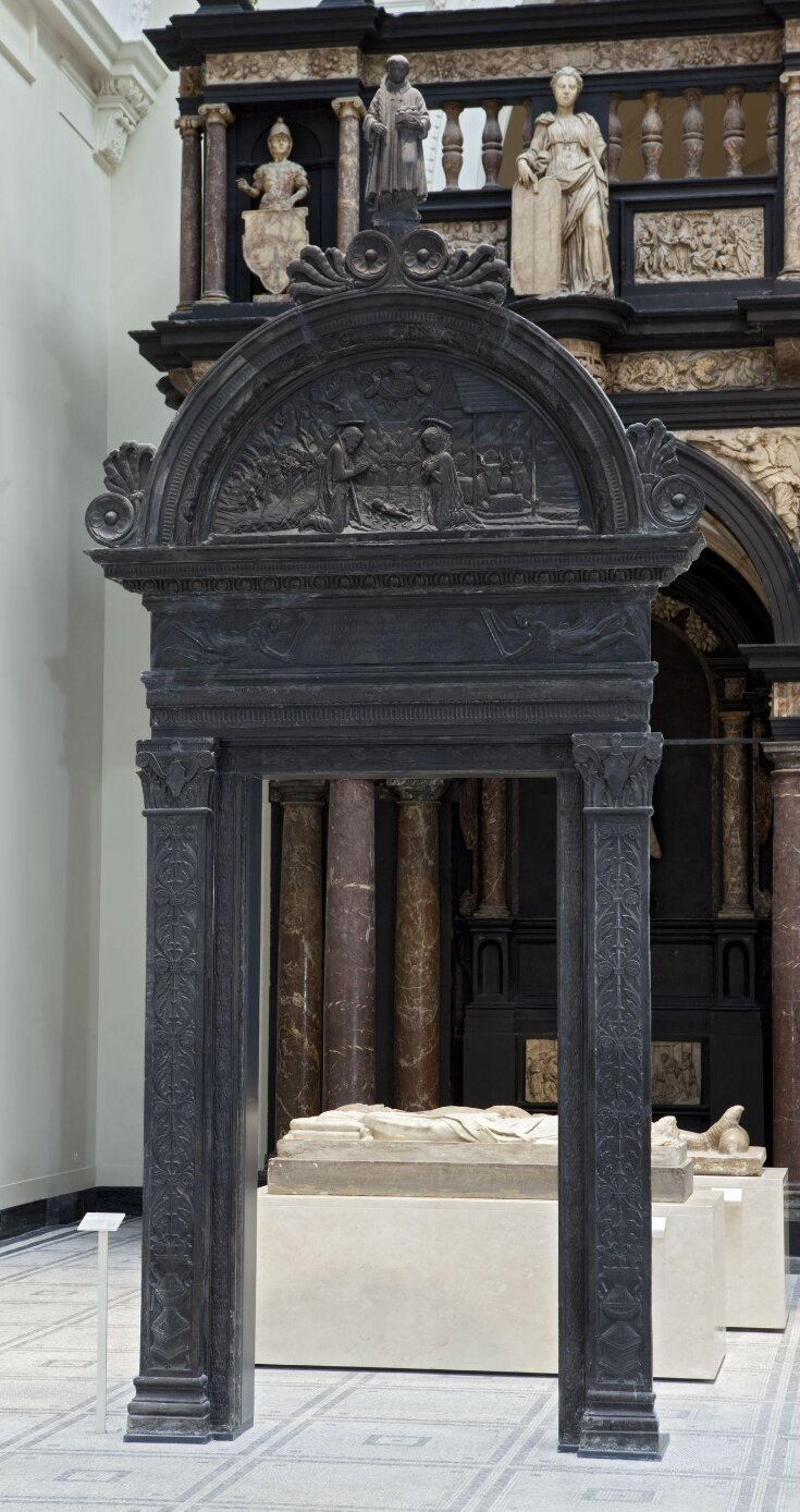 Doorway surmounted by a figure of St. Stephen and carved with a relief of the Nativity top image