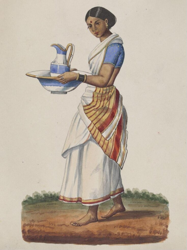 An ayah in a blue choli carrying a china ewer and basin top image
