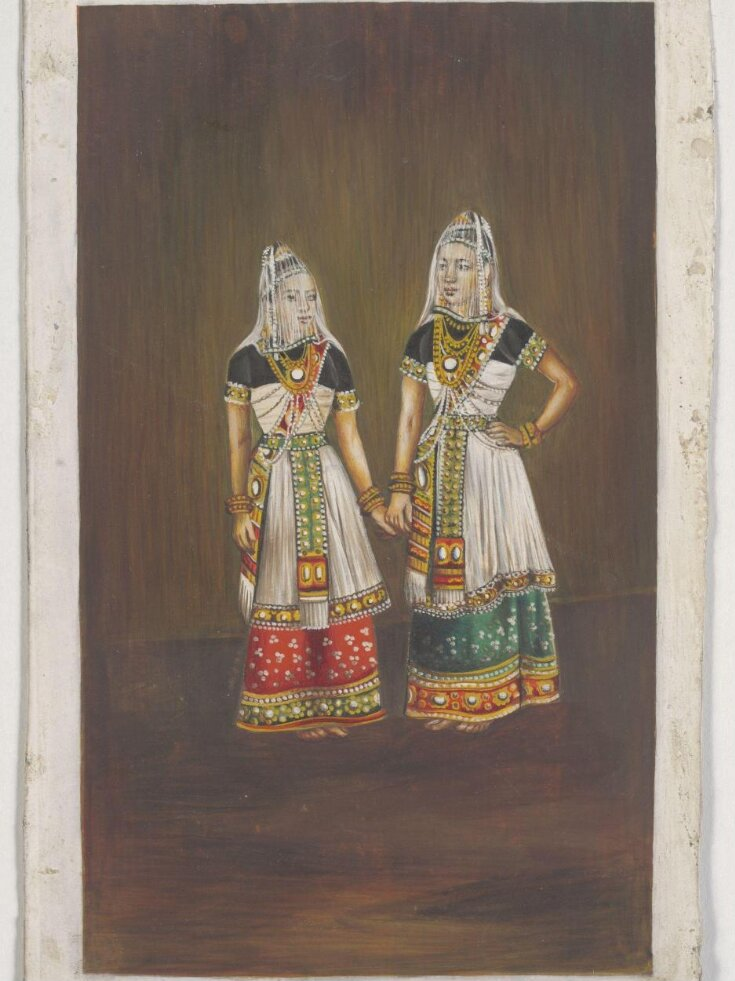Two Manipuri dancing-girls standing together holding hands. top image