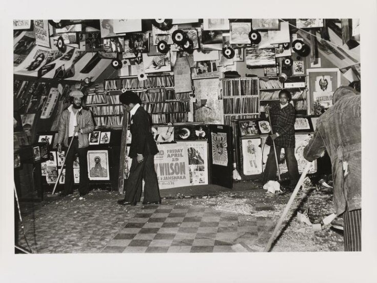 Untitled [Desmond's (standing with broom on left) Hip City records shop in Brixton South, London, damaged by National Front members] top image