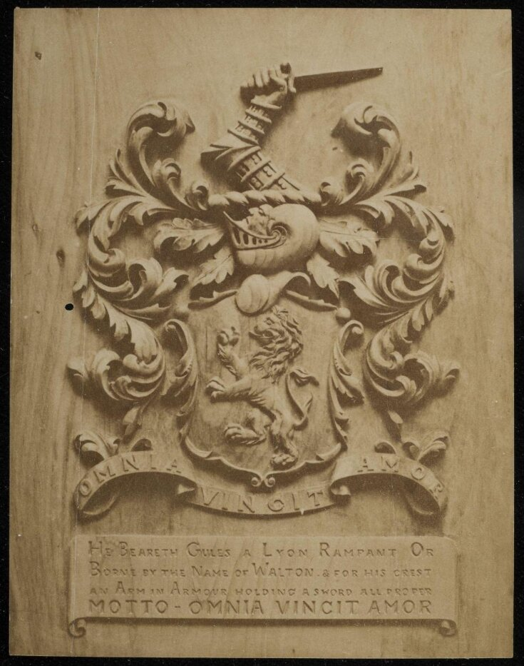 The arms of [illegible inscription] Roberts carved by G AR top image