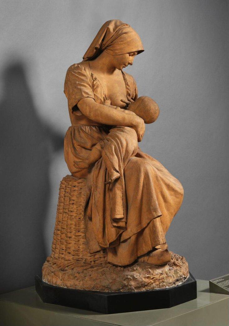 Peasant woman nursing a baby top image
