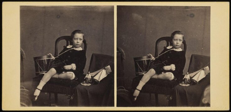 Stereoscopic photograph of a young boy with American flags in Edinburgh top image