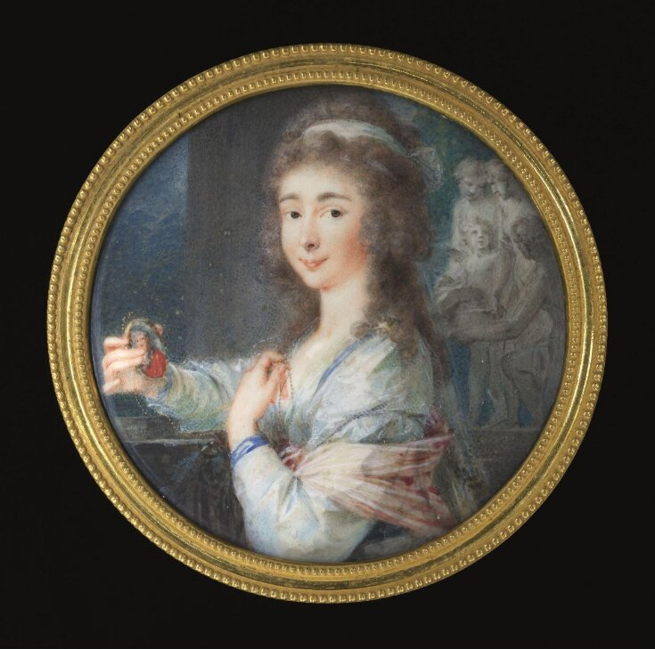 An Unknown woman holding a miniature top image